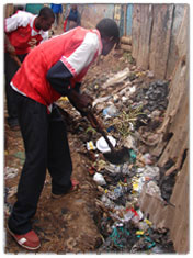 hamlet members doing  clean up in kibera